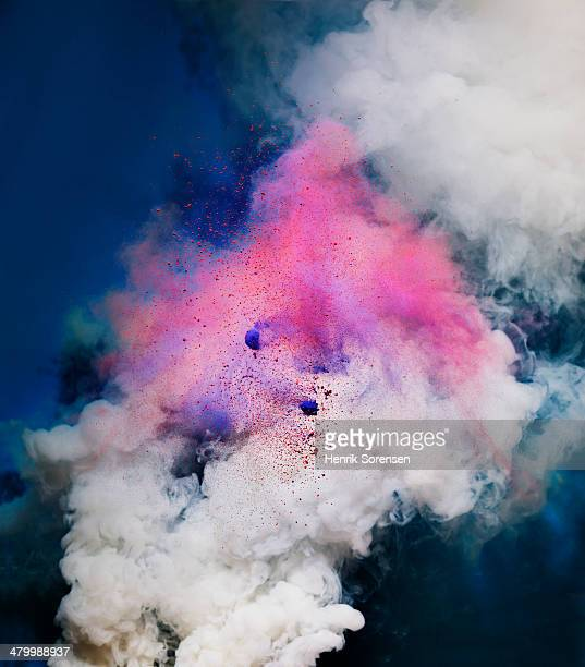 explosion of colored powder and smoke