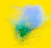 explosion of colored powder, blue and green