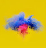 explosion of pink and blue powder