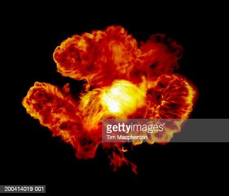 Explosive flame against black background (Digital Composite)