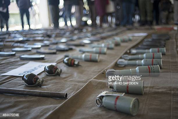 Explosives are displayed on September 1 2014 at the Makoanyane Barracks in Maseru during a press conference to present 130 firearms and a number of...
