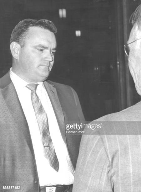 ExPoliceman Appears Before Grand Jury Stanley McClure a former Denver policeman chats with Bailiff Oscar Pearson outside jury room Tuesday Credit...