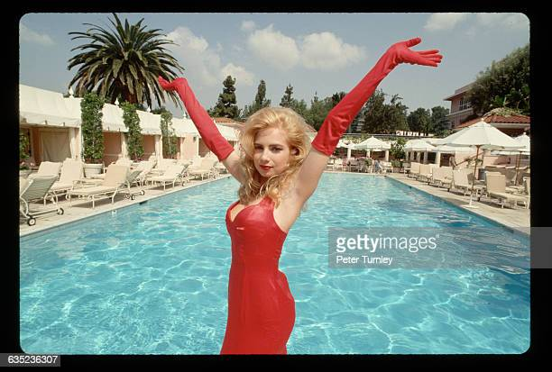 Exporn star Traci Lords poses by the swimming pool at the Beverly Hills Hotel