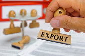 export marked on rubber stamp in hand
