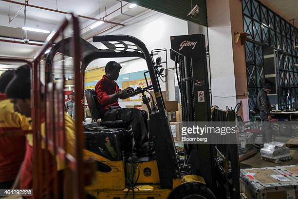 Express India Pvt employee operates a forklift truck at the company's joint hub with Blue Dart Express Ltd in Cargo Terminal 3 at Bengaluru...