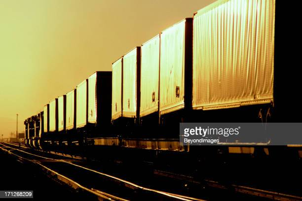 Express intermodal freight train heads into the sunset.