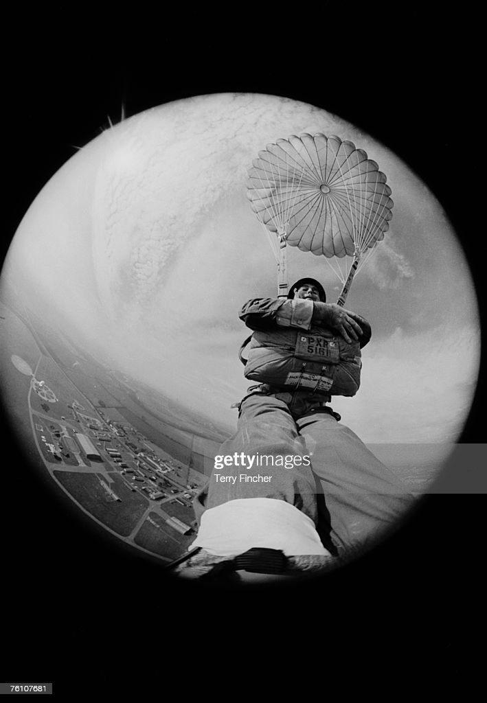 Express photographer Terry Fincher takes a self portrait using a camera strapped to his foot, whilst parachuting from a hot air balloon, 9th March 1966.