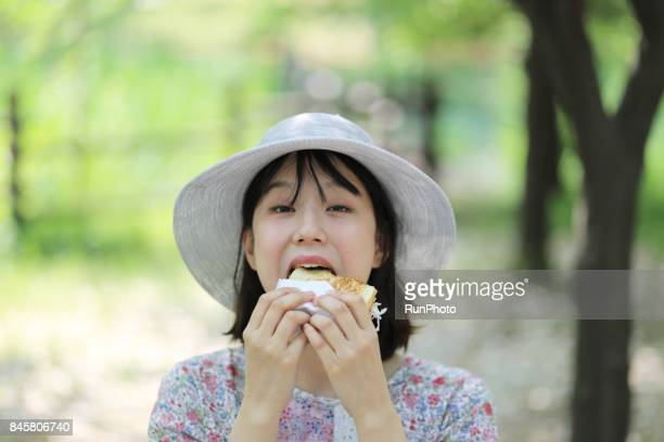 expression of a woman trying to eat bread