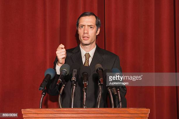 Expressive man behind podium