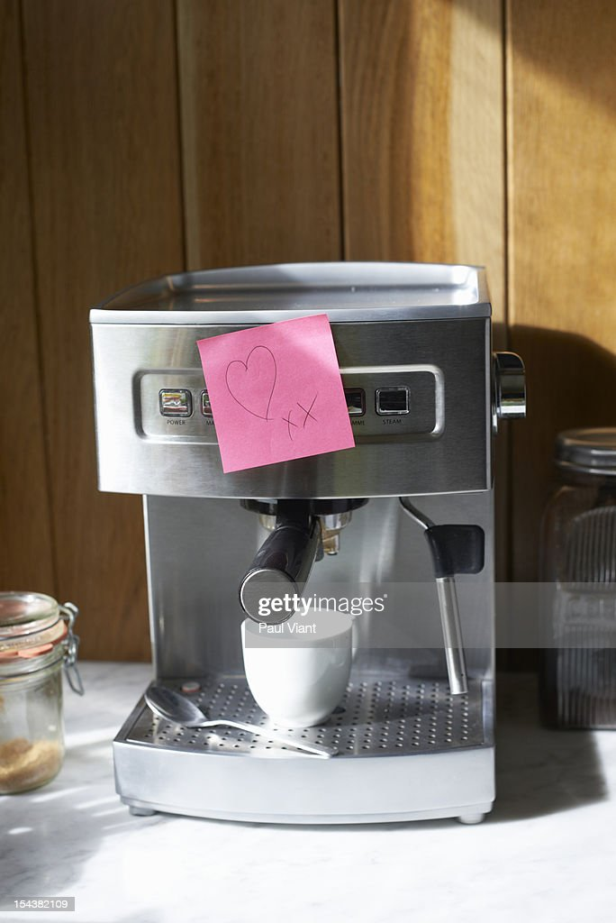 expresso machine with love heart note : Stock Photo