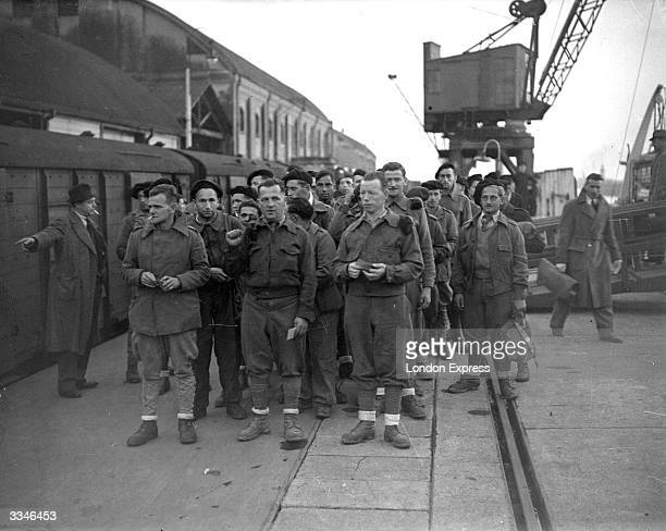 Exprisoners of war from the International Brigade foreign volunteers who fought with the Republican government during the Spanish Civil War arriving...