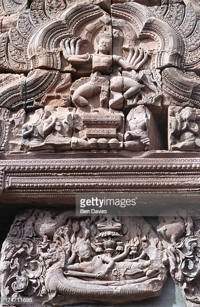 Exquisite sandstone carving of the dancing Shiva his ten arms splayed out in a dance of death and destruction viewed in the Khmer temple complex of...