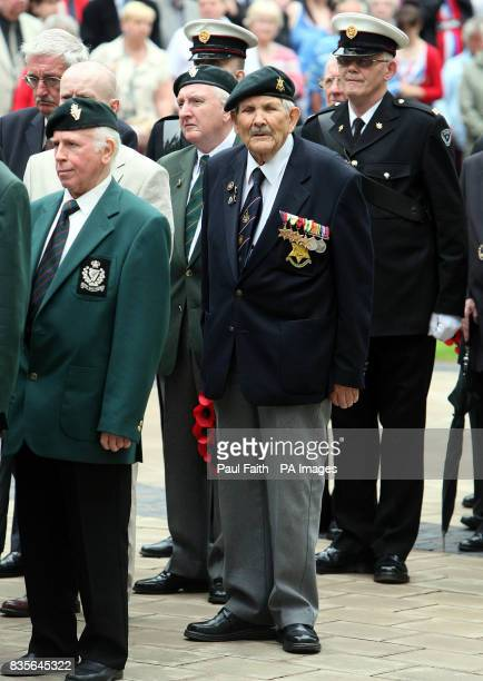 Exserviceman prepare to lay wreaths at the Cenotaph at Belfast City Hall in Northern Ireland