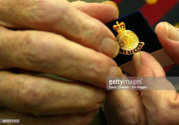 Exserviceman Sandy English 93 shows his medals at the Veteran's Day service and presentation of armed forces badges at Adam Smith College in...
