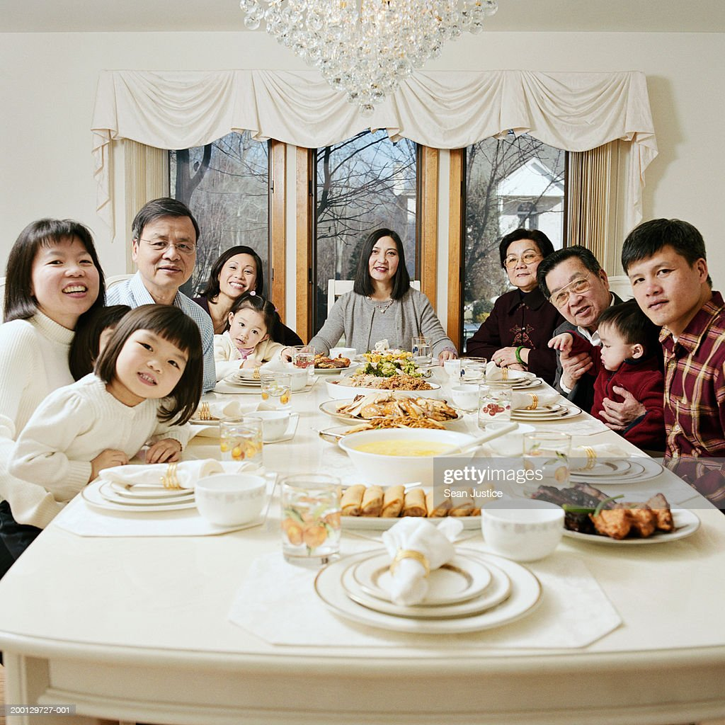 Extended family at dinner table, portrait : Stock Photo