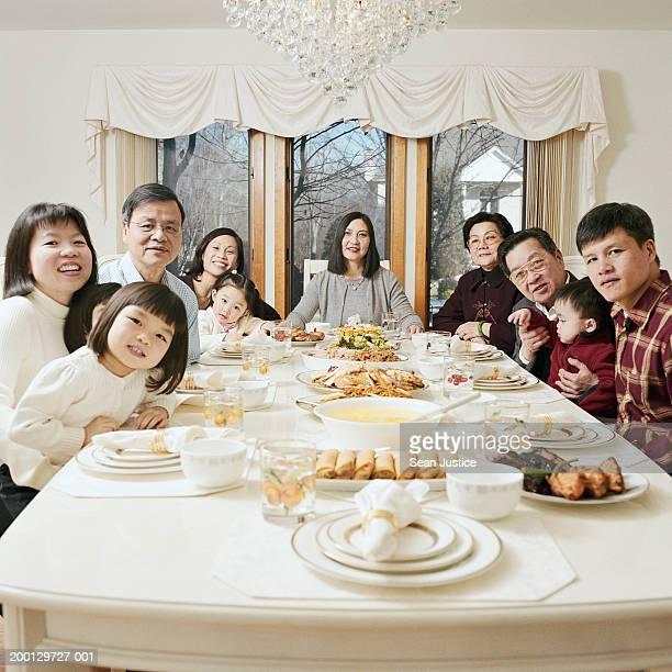 Extended family at dinner table, portrait