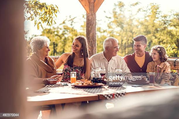 Extended family communicating during a lunch in a restaurant.