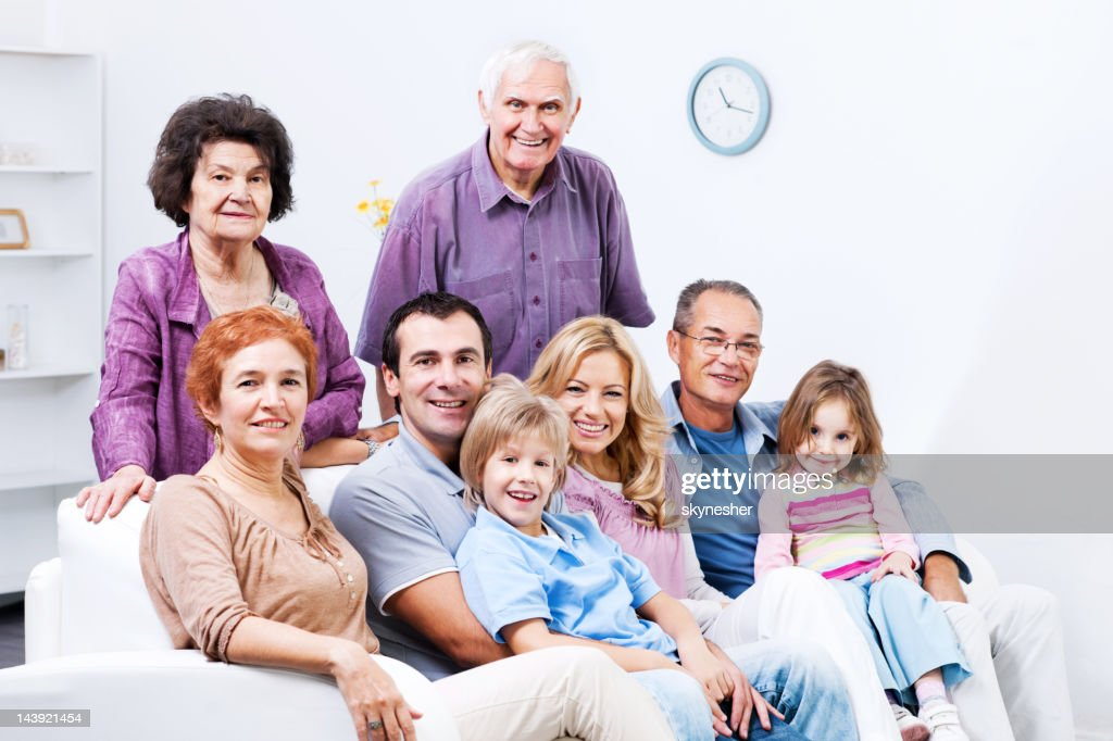 Extended family enjoying at home : Stock Photo