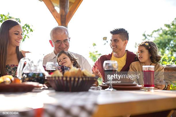 Extended family enjoying during lunch in a restaurant.