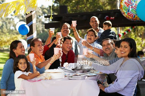 Extended family having party in park : Stock Photo