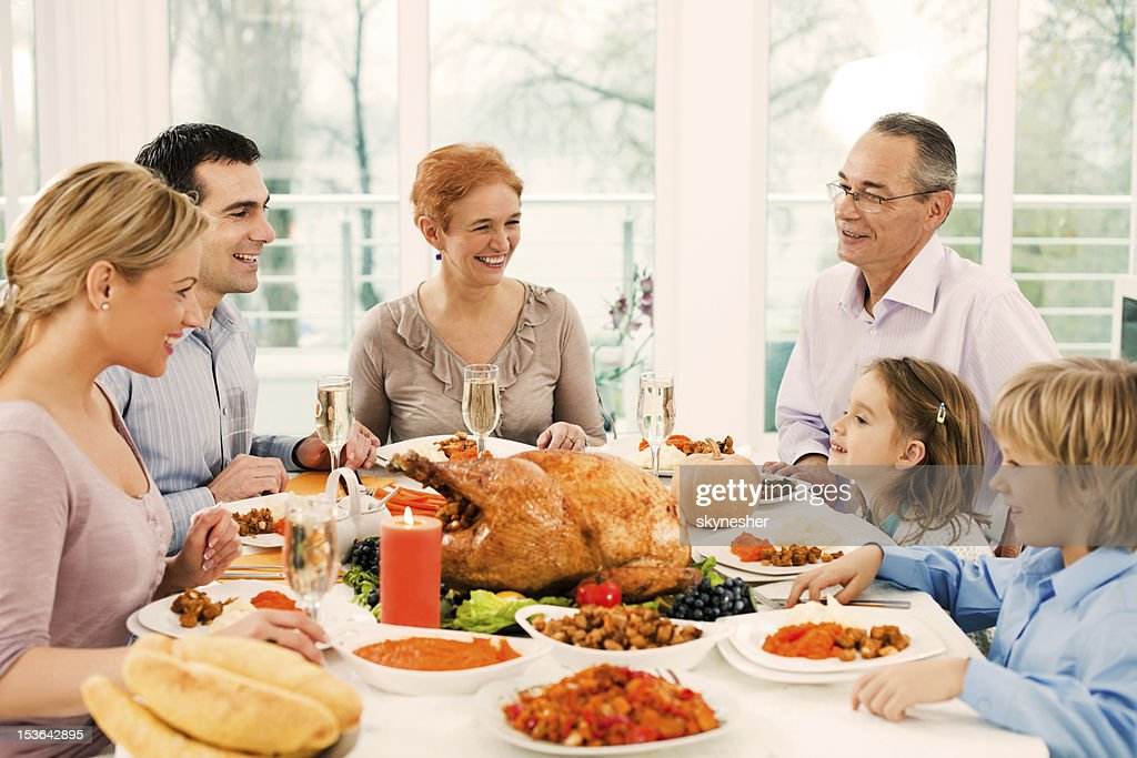 Extended family having thanksgiving dinner.