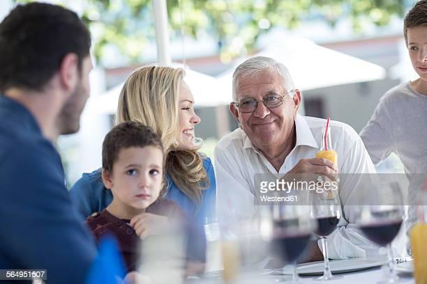 Extended family in restaurant having a celebration