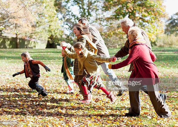 Extended family running in park