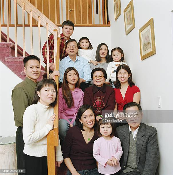 Extended family sitting on staircase, portrait