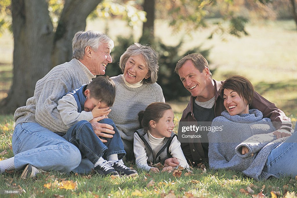 Extended family together outdoors : Stock Photo
