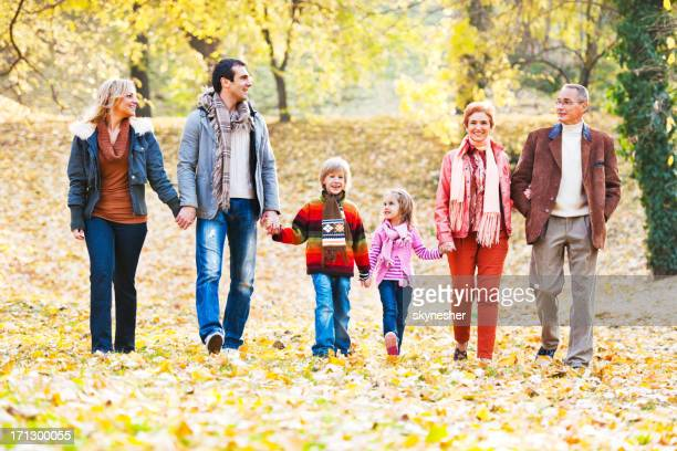 Extended family walking in the park.