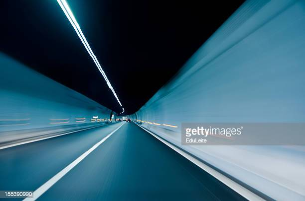 Extended long two-lane tunnel with white lighting