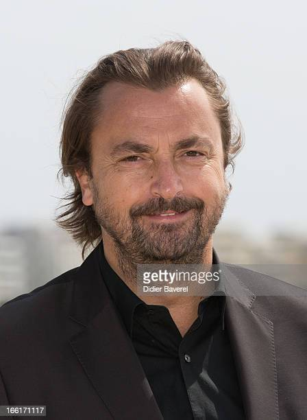 Extennis player Henri Leconte poses during a photocall for the TV Series 'Looking For' at MIP TV 2013 on April 9 2013 in Cannes France