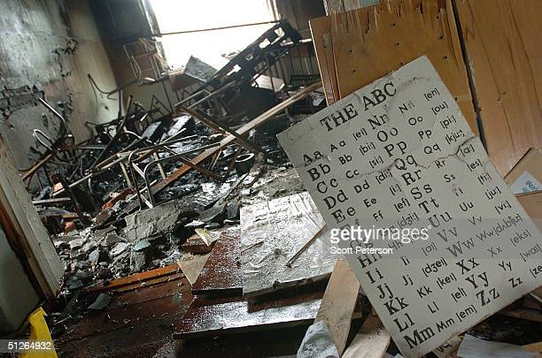 Extensive damage is seen in the ruins of the destroyed school where more than 350 people were killed during a hostage situation on September 5 2004...