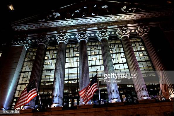 Exterior nighttime view of the New York Stock Exchange which features six columns with Corinthian capitals Lower Manhattan New York New York January...