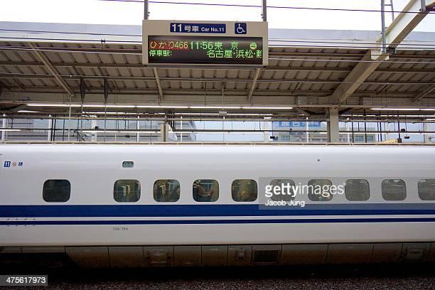 Exterior of an N700 series Shinkansen bullet train stopped at Kyoto Station