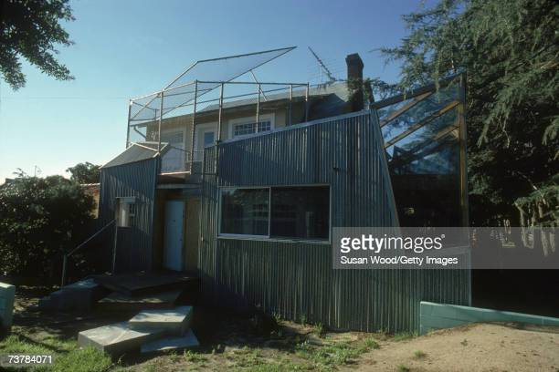 Exterior of Canadianborn American architect Frank Gehry's house which he designed showing the back steps a corrugated iron wall and a balcony...