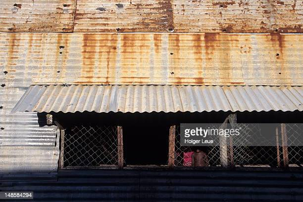 Exterior of corrugated iron house.