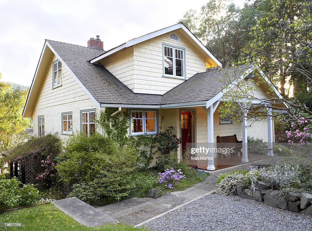 Exterior of cottage style house with front yard : Stock Photo