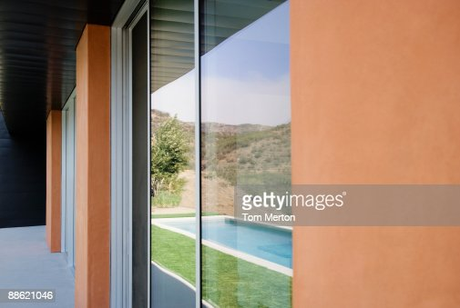 Exterior Of Glass Walls Of Modern House Stock Photo | Getty Images