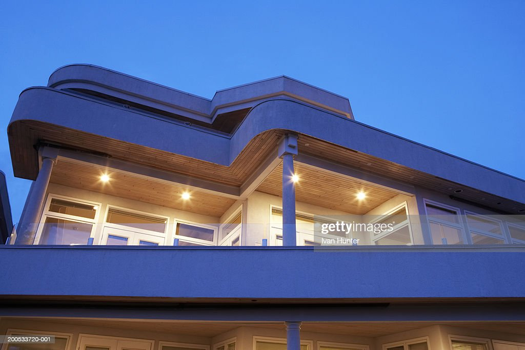 Exterior of house illuminated at dusk, low angle view