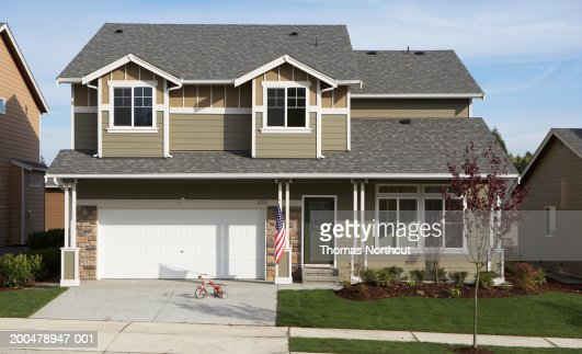 Exterior of house, tricycle in driveway : Stock Photo