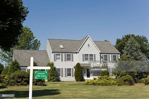 Exterior of house with for sale sign