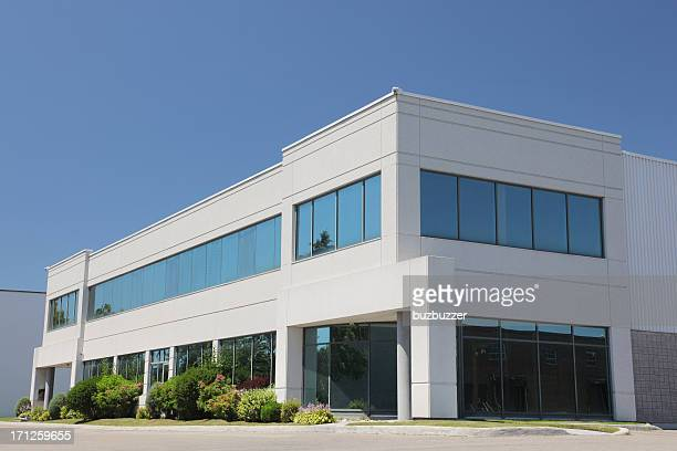 Exterior of modern commercial building, blue sky