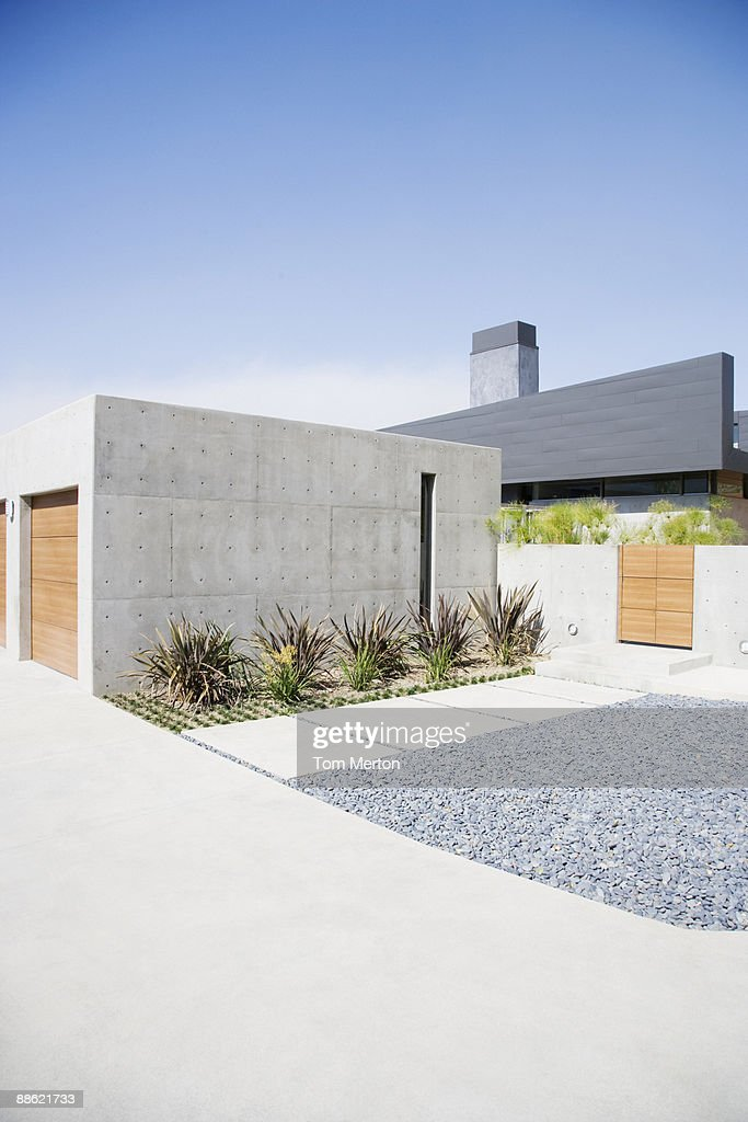 Exterior of modern two-car garage and house : Stock Photo