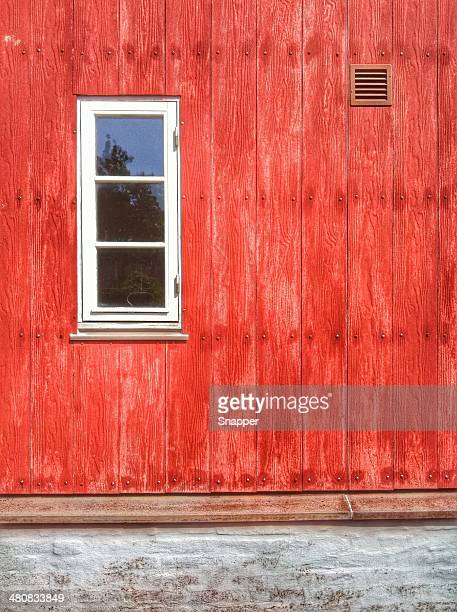 Exterior of red wooden house