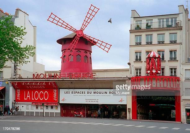 Exterior of the famous cabaret Le Moulin Rouge in Paris France