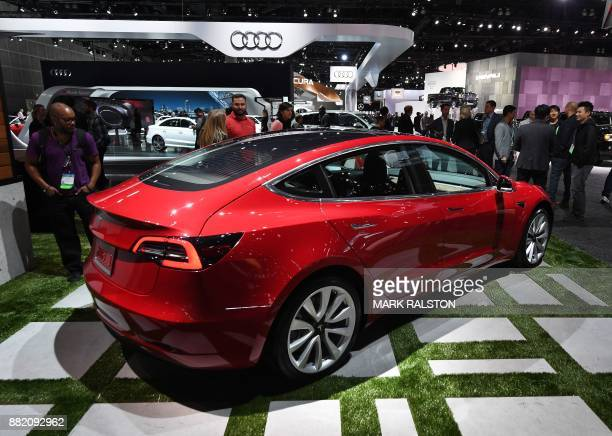 Exterior of the new Tesla Model 3 at the 2017 LA Auto Show in Los Angeles California on November 29 2017 / AFP PHOTO / Mark RALSTON