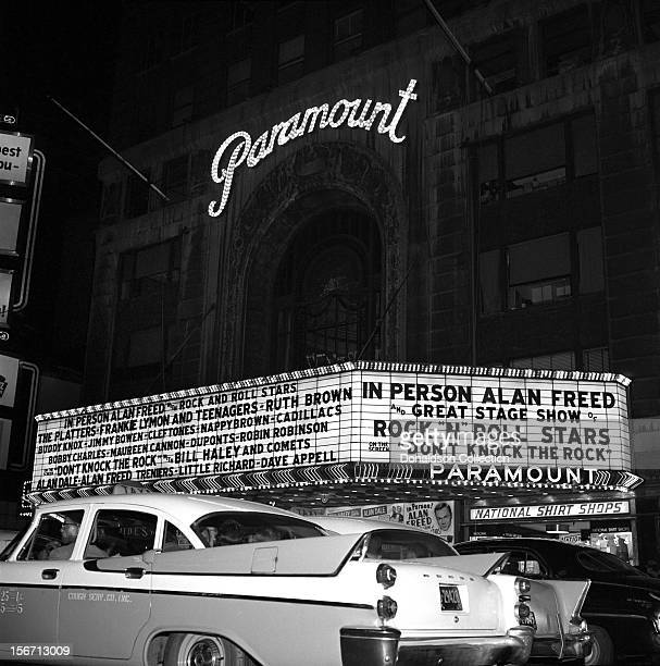 Exterior of the Paramount theater showing the marquee for the Alan Freed show 'Rock and Roll Stars' which reads 'In Person Alan Freed with Rock And...