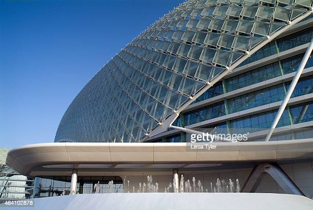 Exterior of the Yas Viceroy Hotel in Abu Dhabi straddling the city's Formula One circuit on a manmade island just north of the city center At night...