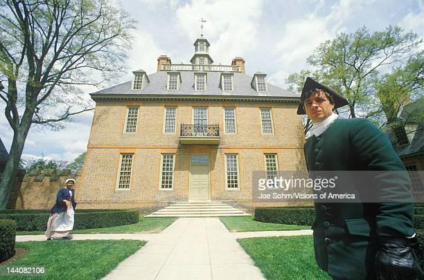 Exterior of Williamsburg Virginia building with actors living history site Williamsburg Virginia